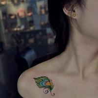 qq头像纹身女生:爱是寂寞的